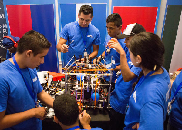 "Team Honduras preps for the competition. The members, who come from a remote village, may have lacked resources, but they know that the ""world today demands that we understand technology,"" said one participant."