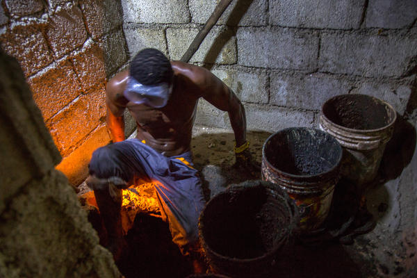 Gabriel Toto, 35, has been working as a <em>bayakou</em>, or latrine cleaner, for a decade. On nights without a journalist watching, he generally works naked.