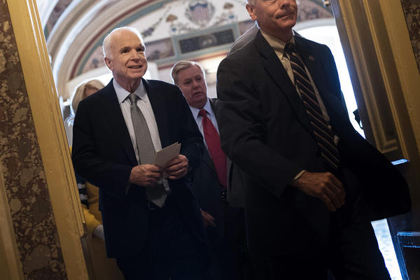 Senator John McCain leaves after a procedural vote on healthcare on Thursday, as the Senate was to vote on moving head on health care with the goal of erasing much of Barack Obama's law.