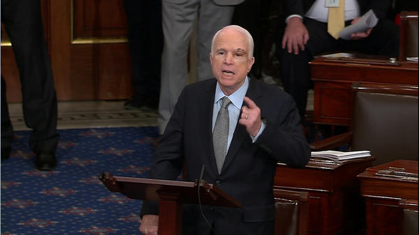 A still image from Senate TV  shows Arizona Sen. McCain speaking on the floor of the Senate after returning to Washington for a vote on healthcare reform.