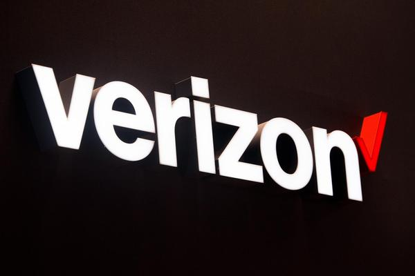 A logo sits illuminated outside the Verizon pavilion during the Mobile World Congress 2017 in Barcelona, Spain. (David Ramos/Getty Images)