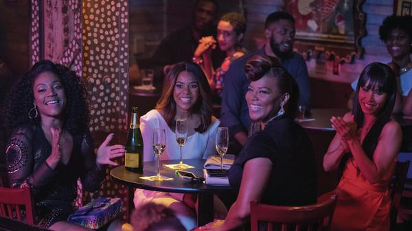 (L to R) Dina (Tiffany Haddish), Ryan (Regina Hall), Sasha (Queen Latifah) and Lisa (Jada Pinkett Smith) paint the town red (and Bourbon Street yellow) in <em>Girls Trip</em>.