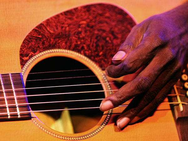 The late Dr. G Yunupingu performing in Melbourne, Australia in 2008. In accordance with Aboriginal custom, his family and record label have requested that no photos of his face be used.