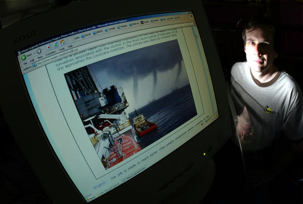 David Mikkelson, founder of Snopes, sits next to a doctored storm photo in 2004. Snopes debunked that image — and has uncovered many other hoaxes. But the future of one of the nation's first digital fact-checking initiatives is currently in doubt.