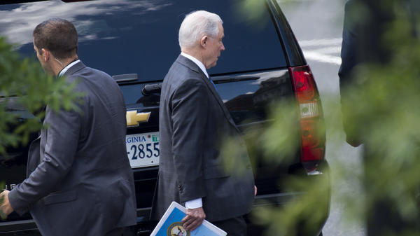 Attorney General Jeff Sessions leaves the White House in Washington, D.C., on Wednesday. Sessions is traveling to El Salvador on Thursday to discuss gang violence with his counterparts there.