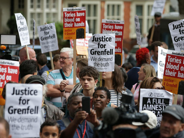 Londoners protest outside a Kensington Council meeting to discuss Grenfell Tower on July 19. British police say there are grounds to suspect the council and other local authorities of committing corporate manslaughter in the fire that killed at least 80 people.