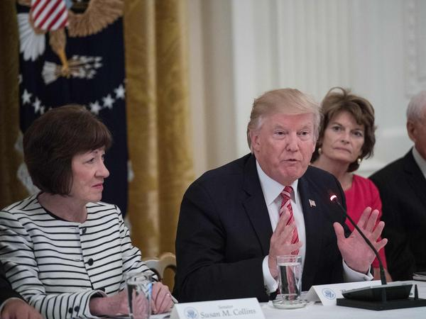President Trump flanked by Sens. Susan Collins, of Maine, (L) and Lisa Murkowski, of Alaska, (R) as GOP senators meet with Trump to discuss the health care bill at the White House on June 27, 2017.