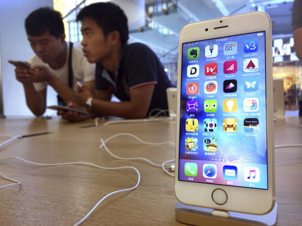 Apple has been accused of removing apps from its China App Store that can be used to skirt the country's Internet filters. Above, customers at an Apple Store in Beijing in 2016.