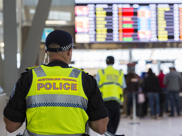 A police officer guards the passenger security check area at Sydney Airport on Sunday.