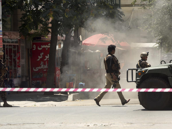 Security forces respond at the site of an attack on the Iraqi Embassy in Kabul. The Islamic State has claimed responsibility.
