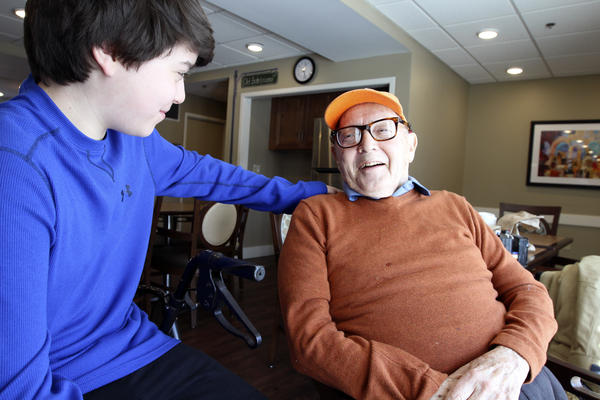 Paul Miller shares a joke with his grandson, Max. They play poker together, but as a numbers guy, Miller is hard to beat.