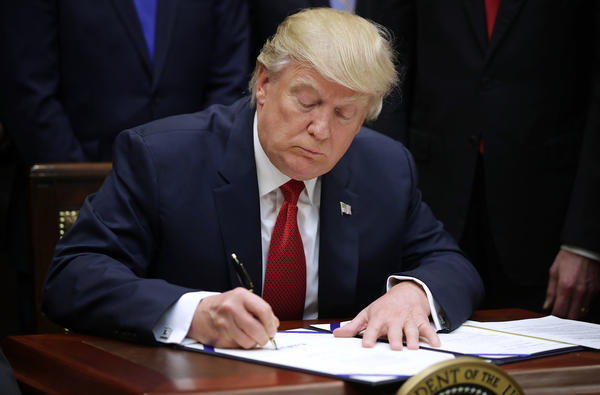 "President Trump signs the Veterans Choice Program Extension and Improvement Act at the White House in April. When they sign legislation, presidents can issue a ""signing statement"" to share their legal interpretation of the new law. Trump did so with the Russia sanctions law."