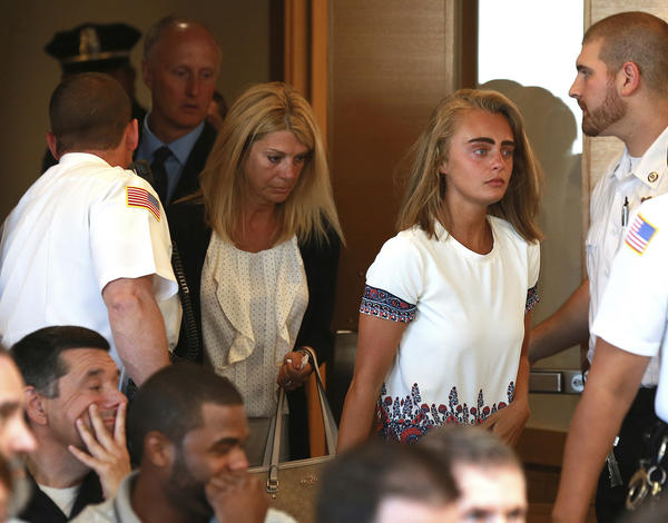 Followed by her parents, Michelle Carter arrives for her sentencing at a courtroom in Taunton, Mass., on Thursday. Carter had been convicted of involuntary manslaughter over the suicide of her boyfriend.