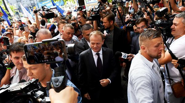 Donald Tusk, president of the European Council and a former Polish prime minister, arrives at the prosecutor's office in Warsaw to deliver testimony Thursday on the 2010 plane crash that killed President Lech Kaczynski.