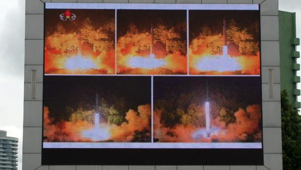 Coverage of a North Korean ICBM missile test is displayed on a screen in a public square in Pyongyang on July 29. It was the country's second missile test in less than a month.