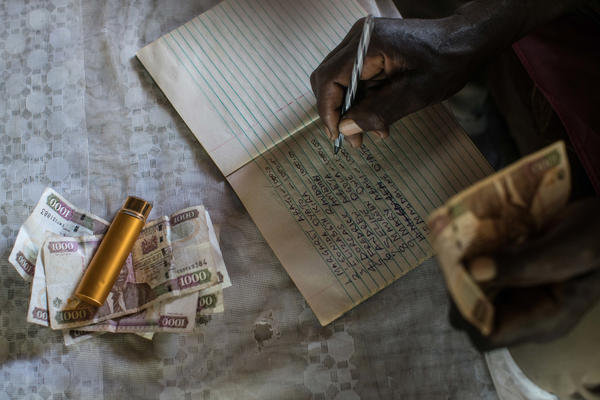 The club treasurer carefully tracks each member's monthly contribution. The success of the clubs belies the stereotype that poor people don't have enough discipline or experience with large sums of money to manage cash aid wisely.