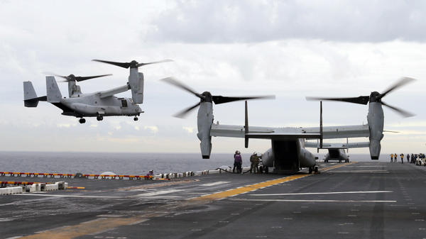 A U.S. Marine Corps MV-22B Osprey aircraft lands on the deck of the USS Bonhomme Richard amphibious assault ship last June off the coast of Sydney, Australia. An MV-22 Osprey that had launched from the USS Bonhomme was conducting regularly scheduled operations when it crashed into the water off Australia's east coast August 5.