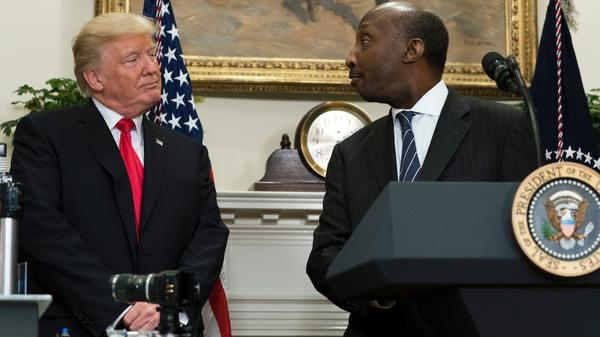 Kenneth Frazier, the CEO of Merck, said he was stepping down from a business council as a matter of personal conscience. He's seen here with President Trump during a White House event in July.