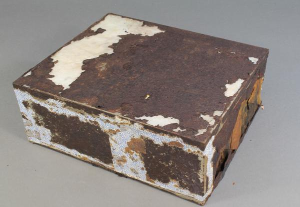 The fruitcake's tin is not as well preserved as the cake itself.