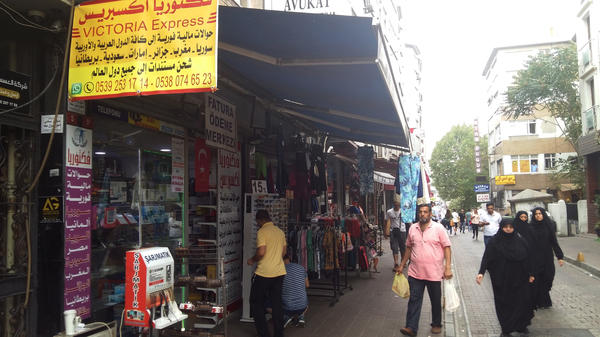 Arabic signs have replaced Turkish ones in Istanbul's Fatih neighborhood, where many Syrian refugees have settled. Turkey has absorbed some 3 million Syrian refugees since the Syrian war began.