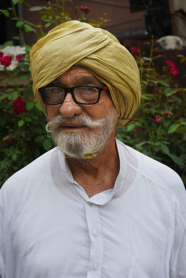 Sardar Sampoorna Singh Virk and his family settled in a home allotted to his family by the Indian government after they'd left behind 800 acres of land in Pakistan.