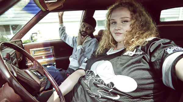 L to R: Jheri (Siddharth Dhananjay) and Patti (Danielle Macdonald) on the road to success in <em>Patti Cake$. </em>