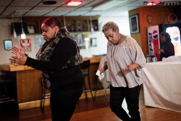 LaVenia Bailey and Irene Hall feel the music at Seafarers Clubhouse on a Friday night in December, 2012.<strong> </strong>