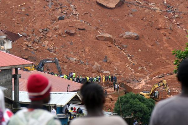 The Red Cross says hundreds of people are still missing after part of a mountainside collapsed early Monday.