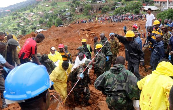 Rescue workers are using heavy equipment and even their hands to dig through the mud, searching for survivors.