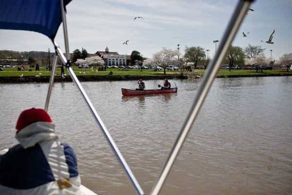 """James """"AJ"""" Hall takes festival goers on electric boat tours of the Anacostia River as part of the first ever Anacostia River Festival in 2015. The area's continued development has brought more attention and more visitors to the river."""