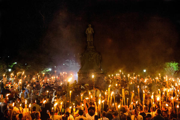 Neo-Nazis, white supremacists and other demonstrators encircle counterprotesters at the base of a statue of Thomas Jefferson on the University of Virginia campus in Charlottesville, Va., on Friday.