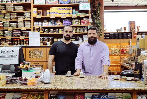Adam Hashem and Ali Alaoieh greet customers as they enter Hashem's Market & Roaster, a family-owned business specializing in fresh, imported spices and traditional Turkish coffee.