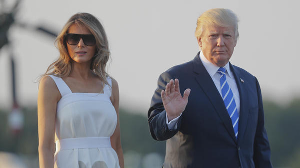 President Trump and first lady Melania Trump walk across the tarmac before boarding Air Force One at Morristown Municipal Airport Sunday to return to Washington.