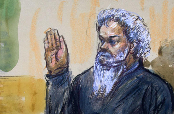 Ahmed Abu Khatallah is sworn in during a hearing at the federal U.S. District Court in Washington, D.C., in June 2014. He has pleaded not guilty to murder and terrorism charges related to the 2012 attack on the U.S. consulate in Benghazi, Libya.