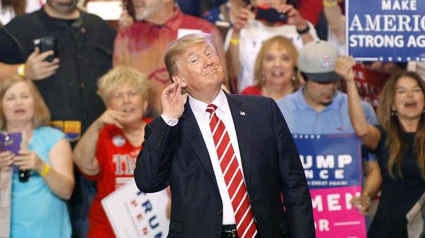 President Trump gestures during a rally at the Phoenix Convention Center Tuesday night.