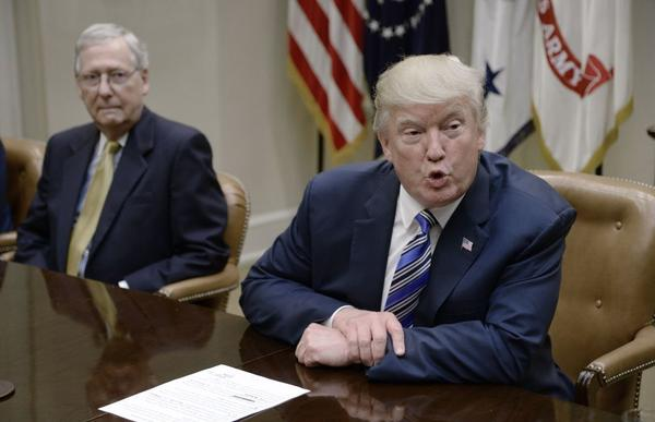 President Trump speaks as Senate Majority Leader Mitch McConnell, R-Ky., looks on during a meeting with House and Senate leadership at the White House in June.