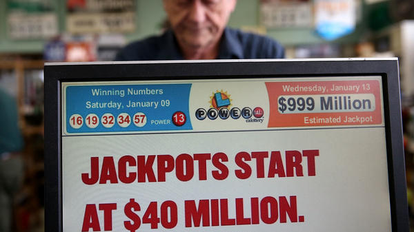 On Jan. 13, 2016, a cashier sells Powerball tickets in San Lorenzo, Calif. Later that day, three winning tickets split the record $1.6 billion jackpot. Wednesday's $758 million jackpot is the largest grand prize won by a single lottery ticket in U.S. history.