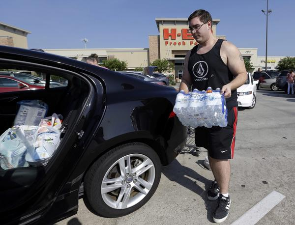 William Hazzard loads water into his car in preparation for tropical weather on Thursday, Aug. 24, 2017, in Houston. Tropical Storm Harvey is expected to intensify over the warm waters of the Gulf of Mexico before reaching the Texas coast Friday. (David J. Phillip/AP)