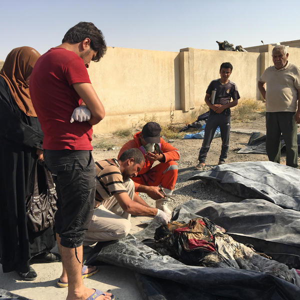 Relatives set about the grim task of identifying bodies of loved ones recovered by civil defense forces in Mosul's Old City.
