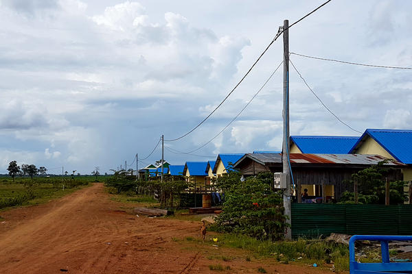 New housing has been built for villagers who agreed to be resettled from Kbal Romeas. The new village is far from the river, so they have to pay for food and water now. Some complain they have not been compensated as they were promised.