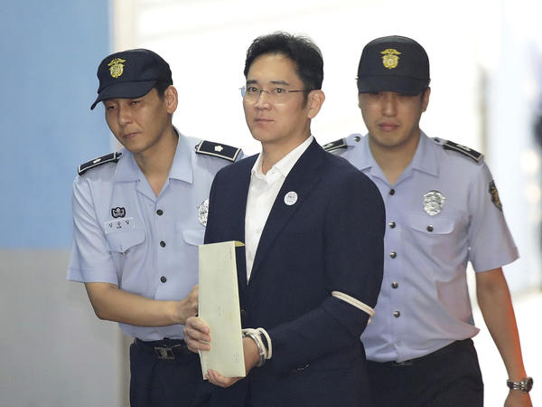 Lee Jae-yong, vice chairman of Samsung, arrives for his trial at Seoul Central District Court on Friday. He was sentenced to five years in prison.