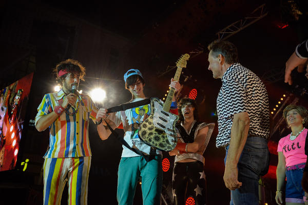 """Matt """"Airistotle"""" Burns (center) took home the top award at the 2016 Air Guitar World Championship in Oulu, Finland. He is back to defend his title this year."""