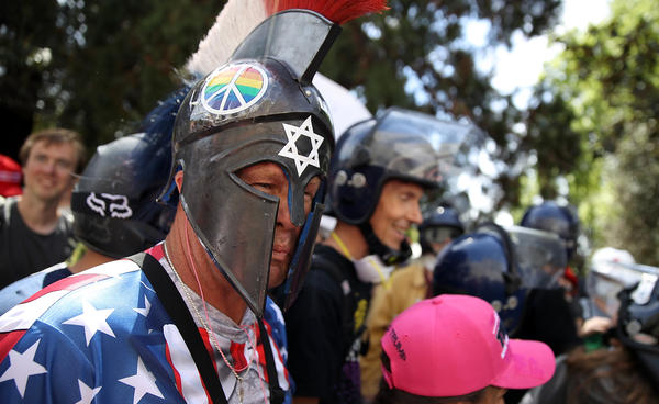 A right-wing activist wears a spartan helmet during a rally at Martin Luther King Jr. Civic Center Park on April 27 in Berkeley, Calif. Protesters gathered in response to the cancellation of a speech by American conservative political commentator Ann Coulter at the university.