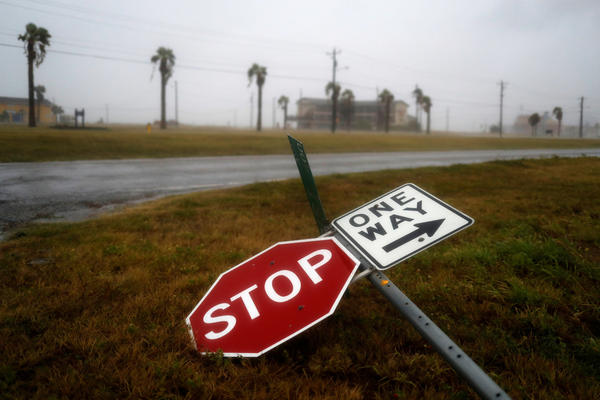 Street signs lie on the ground after winds from Hurricane Harvey escalated on Friday.