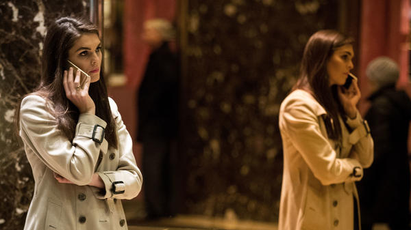 Hope Hicks talks on her phone in the lobby at Trump Tower on December 2016. Her professional style stands in stark contrast to the man who immediately preceded her as communications director, Anthony Scaramucci.