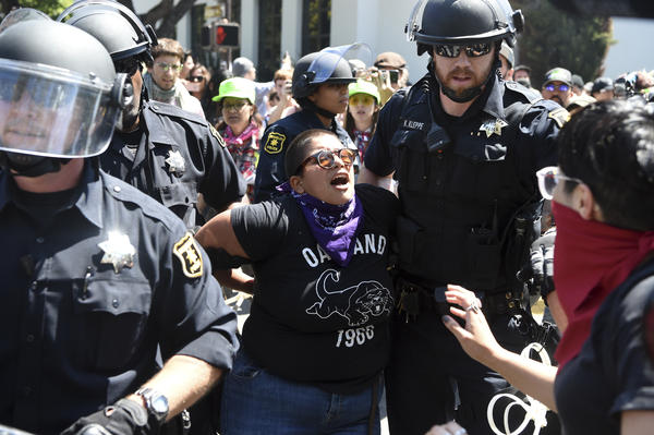 A demonstrator is arrested during Sunday's Rally Against Hate, a response to a planned right-wing protest that raised concerns of violence and triggered a massive police presence. Several people were arrested in Berkeley, Calif., for violating rules against covering their faces or carrying items banned by authorities.