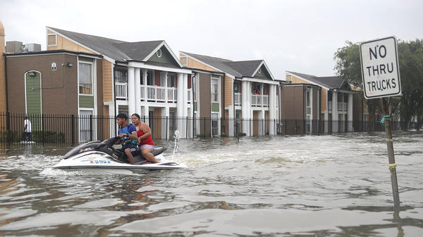 People evacuating homes amidst the flooding in Houston, Texas on Aug. 27.