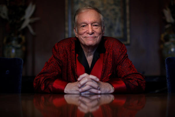 Hefner created <em>Playboy</em> after working as a cartoonist for <em>Esquire</em>. He's pictured here at the Playboy Mansion in 2010.
