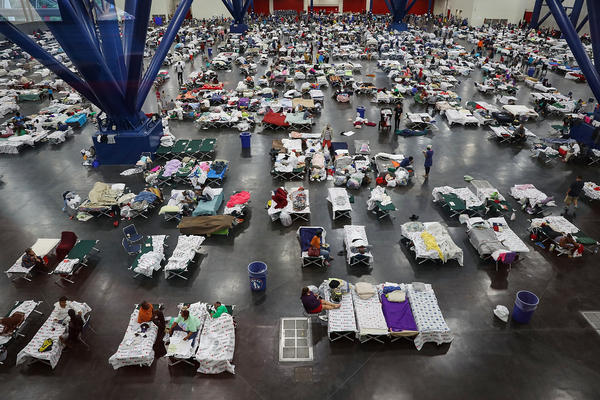 Evacuees fill up cots at a shelter set up inside the George R. Brown Convention Center in Houston, Texas.
