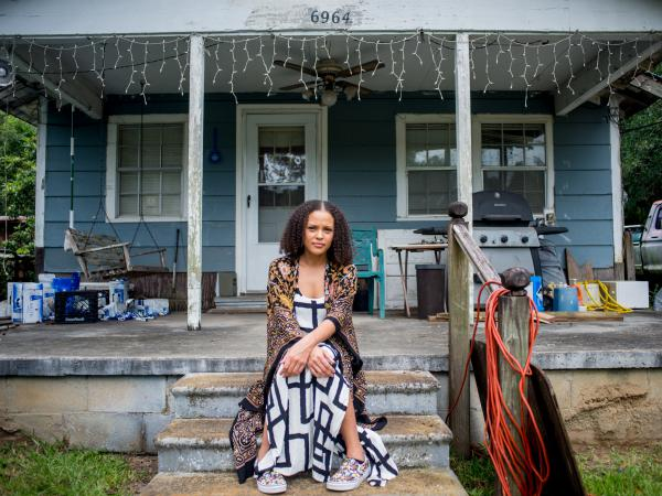 Jesmyn Ward poses for a portrait outside her great-grandmother's house in Pass Christian, Miss.